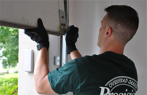 Technician Repairing Garage Door